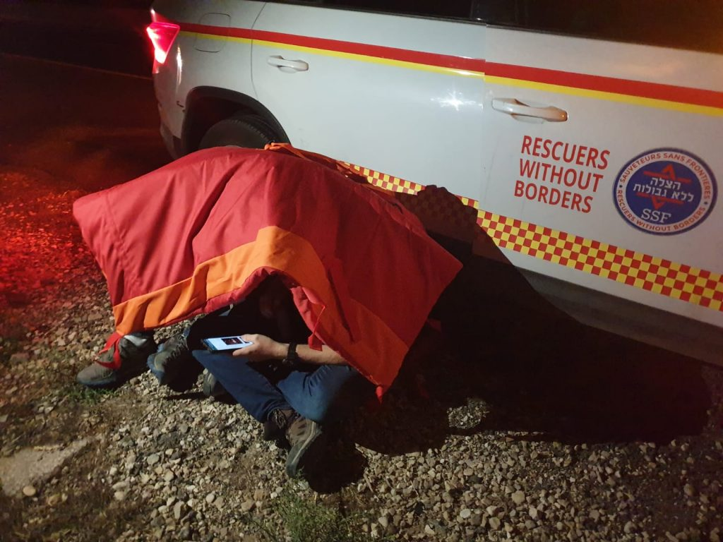Rescuers Protected Under a Protective Shield